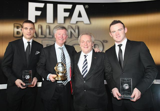 ZURICH, SWITZERLAND - JANUARY 09: Nemanja Vidic (L) and Wayne Rooney (R) of Manchester United pose with their awards after being named in the FIFPro World XI and Sir Alex Ferguson (2nd L) poses with his FIFA Presidential Award for services to football and PFA Chairman Gordon Taylor after the FIFA Ballon d'Or Gala 2011 at Kongresshaus on January 9, 2012 in Zurich, Switzerland. (Photo by John Peters/Man Utd via Getty Images)