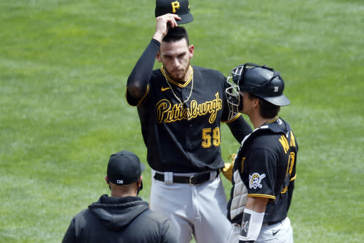 Pittsburgh Pirates pitcher Joe Musgrove, center, gets a mound visit in the first inning of a baseball game against the Minnesota Twins, Tuesday, Aug. 4, 2020, in Minneapolis. Musgrove gave up three runs in the inning. (AP Photo/Jim Mone)