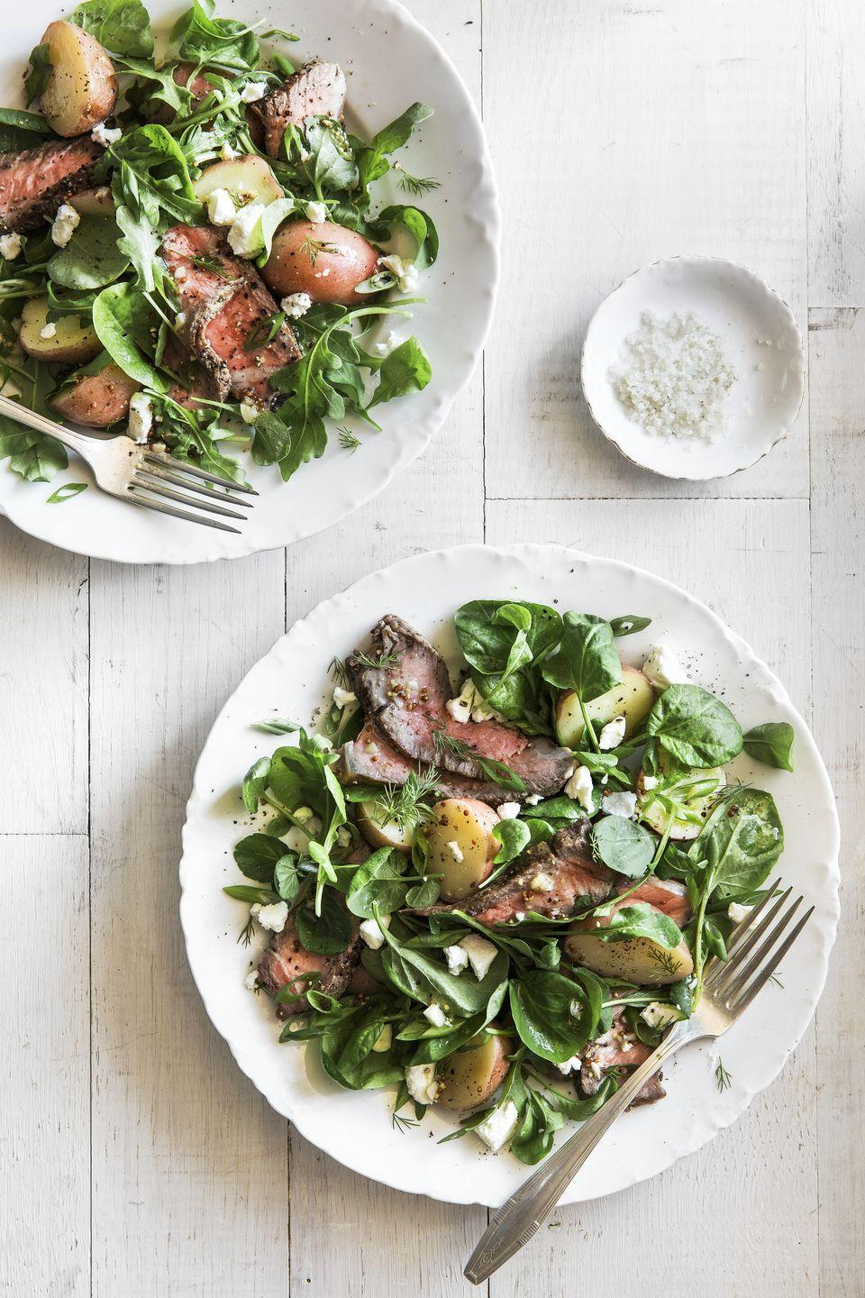 """<p>This steak-and-potato salad is a light and flavorful way to savor red meat.</p><p><strong><a href=""""https://www.countryliving.com/food-drinks/recipes/a35066/steak-and-potato-salad-1/"""" rel=""""nofollow noopener"""" target=""""_blank"""" data-ylk=""""slk:Get the recipe"""" class=""""link rapid-noclick-resp"""">Get the recipe</a>.</strong></p>"""