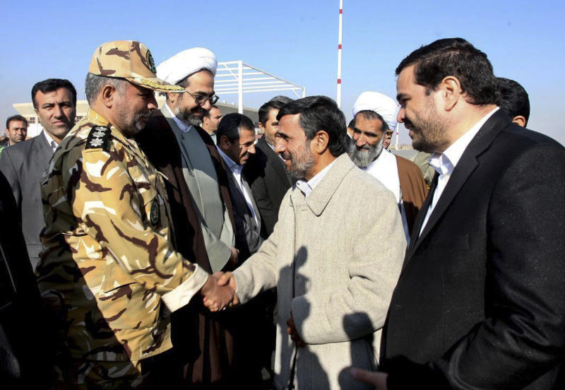 "In this image provided by the Presidency Office, Iranian President Mahmoud Ahmadinejad, second right, shakes hands with an unidentified army colonel as he arrives at the Shahr-e-Kord, during his provincial tour, in central Iran, Wednesday, Nov. 9, 2011. Iran won't retreat ""one iota"" from its nuclear program but the world is being misled by claims that it seeks atomic weapons, President Mahmoud Ahmadinejad said Wednesday in his first reaction since a U.N. watchdog report that Tehran is on the brink of developing a warhead. (AP Photo/Presidency Office, Ebrahim Seyyedi)  EDITORIAL USE ONLY, NO SALES"