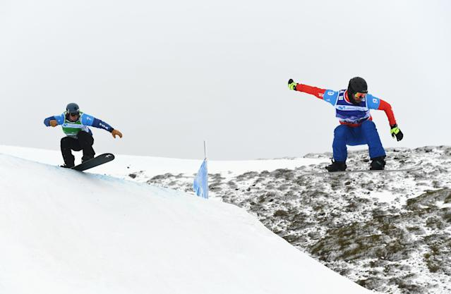 <p>SIERRA NEVADA, SPAIN – MARCH 13: Lukas Pachner (R) of Austria competes with Alex Deibold of the United States during the Men's Team Snowboard Cross Small Final on day six of the FIS Freestyle Ski and Snowboard World Championships. (Getty Images) </p>