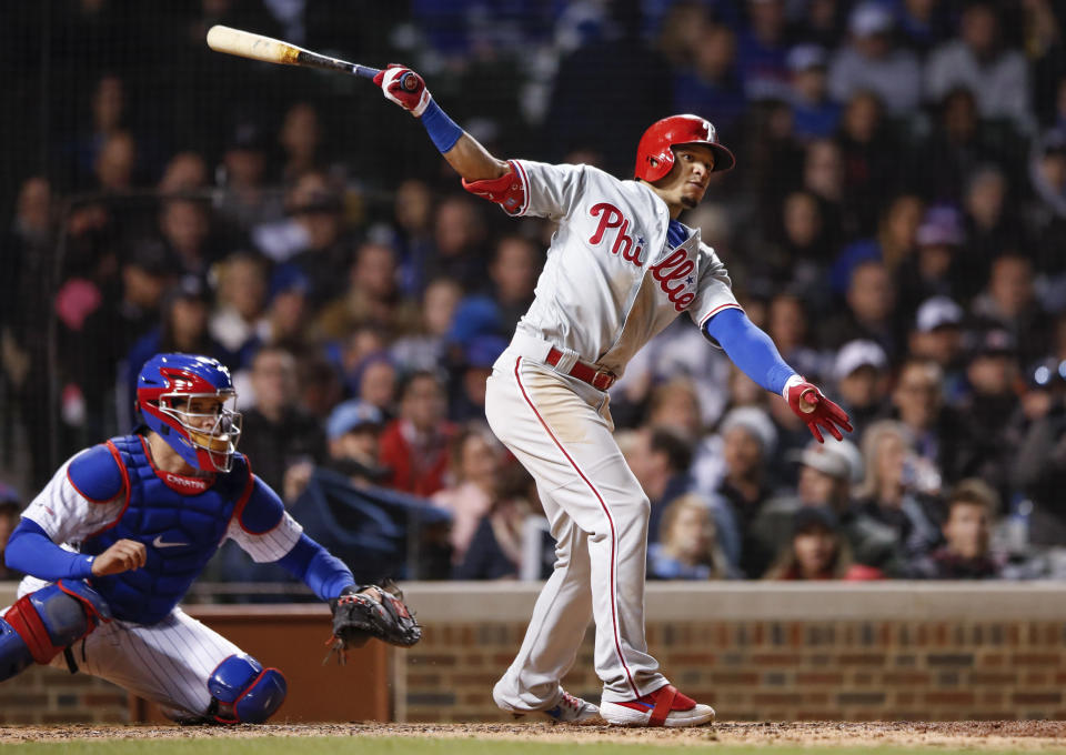 Philadelphia Phillies' Cesar Hernandez, right, watches his two-RBI triple off of Chicago Cubs' Yu Darvish during the sixth inning of a baseball game, Monday, May 20, 2019, in Chicago. (AP Photo/Kamil Krzaczynski)