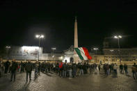 FILE - In this Saturday, Oct. 24, 2020 file photo, people gather in Piazza del Popolo square during a protest called by Forza Nuova far right group against the government restriction measures to curb the spread of COVID-19, in Rome. An extreme-right political party's violent exploitation of anger over government anti-pandemic restrictions is forcing Italy to wrestle with its fascist legacy and fueling fears that there could be a replay of last week's mobs trying to force their way toward Parliament. (Cecilia Fabiano/LaPresse via AP, File)
