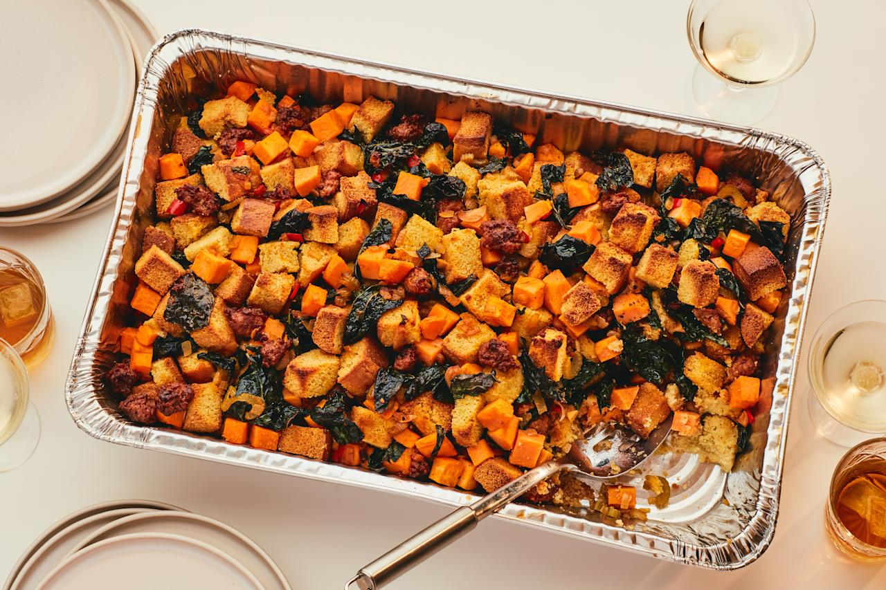 "This flavor-packed holiday side feeds a crowd of 20 and takes care of both the stuffing and the sweet potatoes. If you don't like spicy dishes, omit (or reduce) the fresh chiles. <a rel=""nofollow"" href=""https://www.epicurious.com/recipes/food/views/spicy-cornbread-stuffing-with-chorizo-and-sweet-potatoes?mbid=synd_yahoo_rss"">See recipe.</a>"