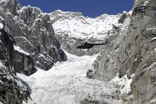 A Pakistan Army helicopter flies over the site of an avalanche near the Siachen glacier in April 2012. Pakistan's army chief of staff, General Ashfaq Kayani, has called for a negotiated end to the stalemate with India over the glacier and said it should be demilitarised after an avalanche on April 7 killed 140 people at a Pakistani army camp