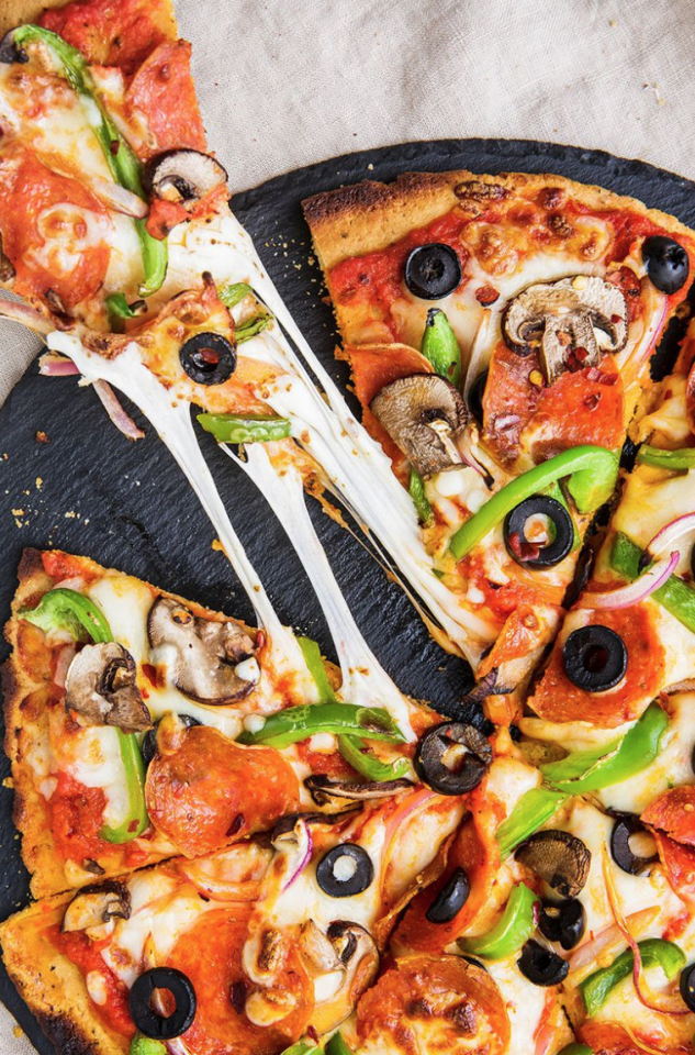 "<p>No gluten or dairy, no problem. </p><p>Get the recipe from <a href=""https://www.delish.com/cooking/recipe-ideas/a25337271/paleo-pizza-recipe/"" target=""_blank"">Delish</a>. </p>"