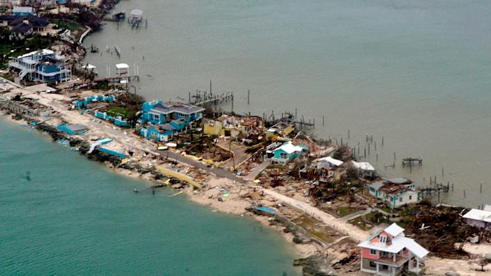 A U.S. Coast Guard aircraft surveys damaged homes and piers in the Bahamas on Sept. 3 after Hurricane Dorian.