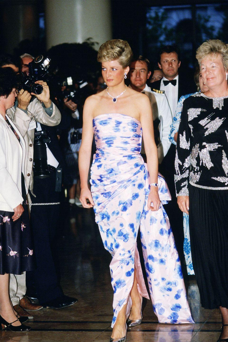 <p>In a gown by Catherine Walker and sparkling jewels at a dance in Melbourne during the Royal Tour of Australia. </p>