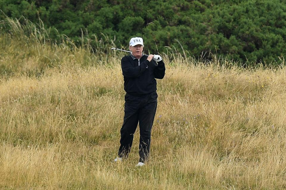 Mr Trump played at his own course at Turnberry in Scotland during an official visit to the UK: Getty