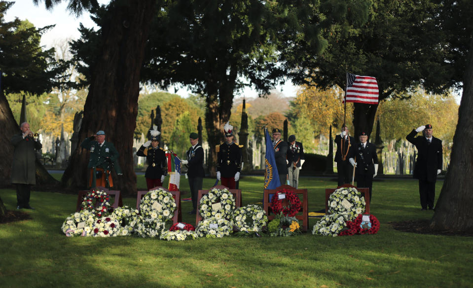 Flag bearers during a ceremony of allied nations at Glasnevin cemetery in Dublin, Ireland, to mark Armistice Day, the anniversary of the end of the First World War, Monday Nov. 11, 2019. Ceremonies around the world are marking guns falling silent to end hostilities and end World War One, on the eleventh hour of the eleventh day of the eleventh month of 1918. (Niall Carson/PA via AP)