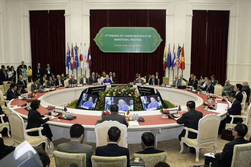 U.S. Secretary of State Hillary Rodham Clinton, rear center, gives a speech during second Friends of Lower Mekong Ministerial Meeting in Phnom Penh, Cambodia, Friday, July 13, 2012. (AP Photo/Heng Sinith)