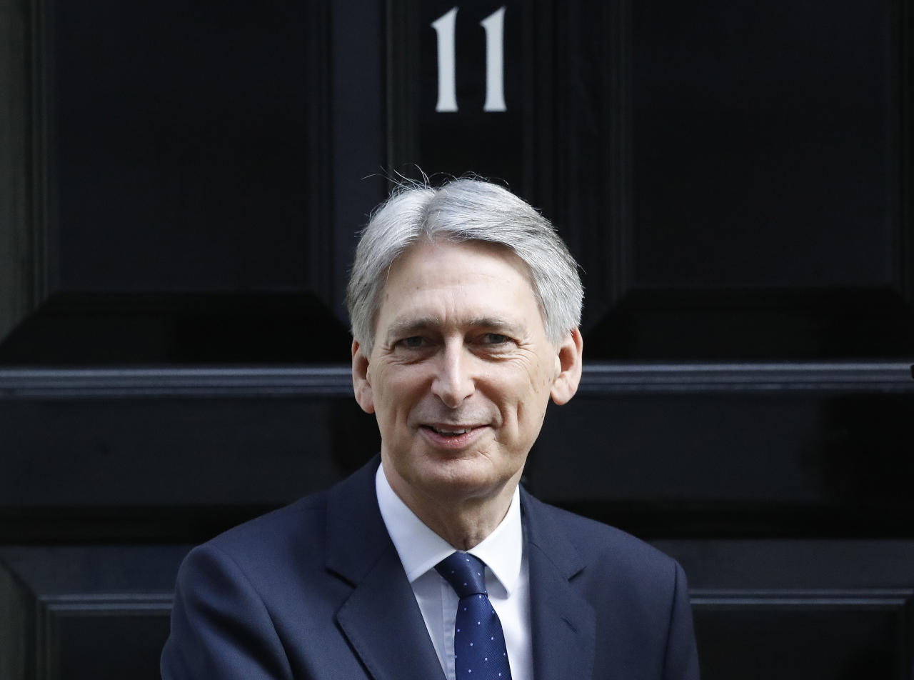<p> FILE - In this Thursday, March 16, 2017 file photo, Britain's Chancellor Philip Hammond walks out of 11 Downing Street in London. Britain's Treasury chief is likely to ignore demands that the government ease seven years of austerity when he unveils the budget Wednesday Nov. 22, 2017, opting instead to keep a tight rein on spending as economic growth slows and the country prepares for the impact of Brexit. (AP Photo/Frank Augstein, File) </p>