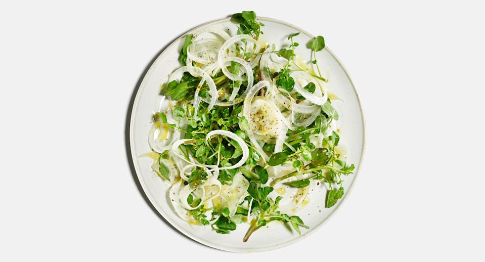 """Soaking the onion slices in ice water rids them of their sulfury smell and firms them up. <a href=""""https://www.bonappetit.com/recipe/white-onion-fennel-and-watercress-salad?mbid=synd_yahoo_rss"""" rel=""""nofollow noopener"""" target=""""_blank"""" data-ylk=""""slk:See recipe."""" class=""""link rapid-noclick-resp"""">See recipe.</a>"""