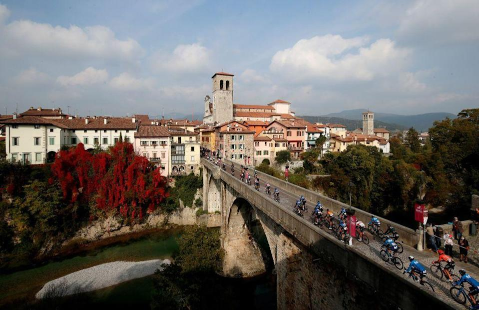 Cyclists ride over the Ponte del Diavolo  Diable bridge  in Cividale del Friuli during the 16th stage of the Giro dItalia 2020 cycling race a 229 km between Udine and San Daniele in Udine on October 20 2020 Photo by Luca Bettini  AFP Photo by LUCA BETTINIAFP via Getty Images