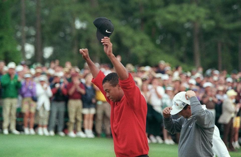 Tiger Woods raises his arms in victory after winning the 1997 Masters tournament, a turning point for the sport, the man and even the course (AFP Photo/JEFF HAYNES)