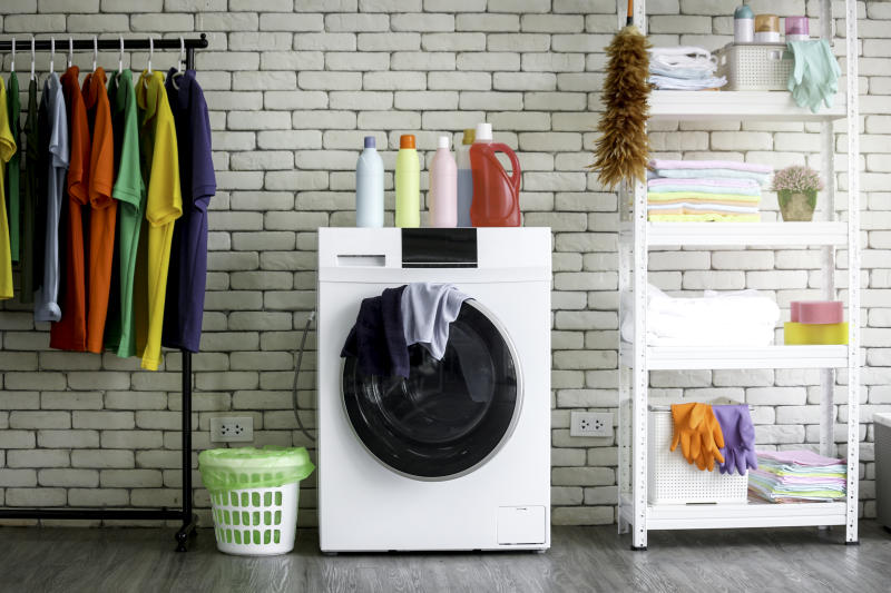 Washing machine in laundry room at home
