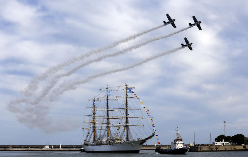"""FILE - In this Jan. 9, 2013 file photo, Argentina's naval training tall ship ARA Libertad arrives to port as planes fly overhead during a ceremony in Mar del Plata, Argentina Ghana courts ordered the ship held in October on a claim by Cayman Islands-based hedge fund NML Capital Ltd. But the U.N.'s International Tribunal for the Law of the Sea ordered the ship's release after Argentina argued that warships are immune from seizure. Judgment day is approaching in an epic battle between Argentina and New York billionaire Paul Singer, who has sent lawyers around the globe trying to force the South American country to pay its defaulted debts. Three U.S. appellate judges will hear oral arguments in New York on Wednesday, Feb. 27, 2013, in the case, NML Capital Ltd. v. Argentina. The case has shaken bond markets, worried bankers, lawyers and diplomats, captivated financial analysts and generated enough """"friend of the court"""" briefs to kill a small forest. (AP Photo/Natacha Pisarenko, File)"""