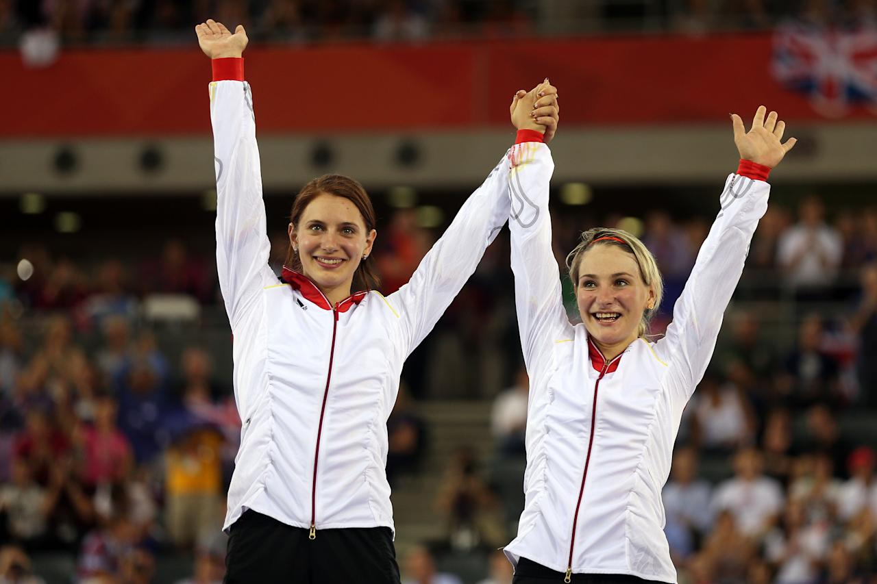 LONDON, ENGLAND - AUGUST 02:  Miriam Welte (L) and Kristina Vogel of Germany celebrate on the podium before receiving their gold medals during the medal ceremony for the Women's Team Sprint Track Cycling on Day 6 of the London 2012 Olympic Games at Velodrome on August 2, 2012 in London, England.  (Photo by Bryn Lennon/Getty Images)