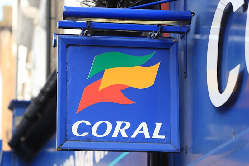 A view of a sign for a Coral betting shop in London.