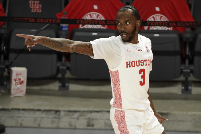 Houston guard DeJon Jarreau reacts after making a three-point basket during the first half of an NCAA college basketball game against South Florida, Sunday, Feb. 28, 2021, in Houston. (AP Photo/Eric Christian Smith)
