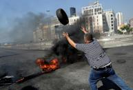 Lebanese demonstrators burn tires as they protest against dire living conditions amidst the ongoing economical and political crisis