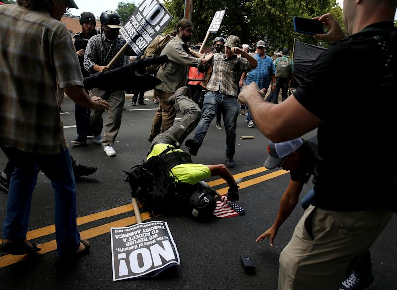 A white supremacist fights with counter-protesters in Charlottesville, Virginia, on Saturday. (Joshua Roberts / Reuters)
