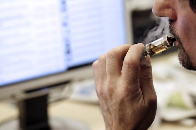 E-cigarette advocates argue that the device offers the smoker nicotine in a liquid, thus preventing the combustion of tobacco that releases most toxins (AFP Photo/Kenzo Tribouillard)