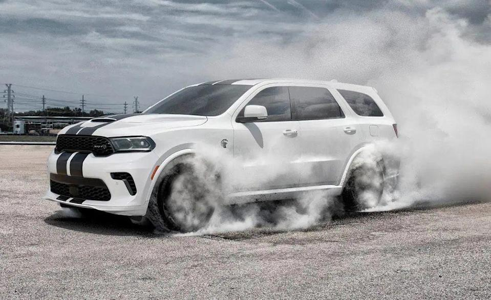 """<p>The <a href=""""https://www.caranddriver.com/dodge/durango"""" rel=""""nofollow noopener"""" target=""""_blank"""" data-ylk=""""slk:Dodge Durango"""" class=""""link rapid-noclick-resp"""">Dodge Durango</a> shares its underpinnings with the <a href=""""https://www.caranddriver.com/dodge/charger"""" rel=""""nofollow noopener"""" target=""""_blank"""" data-ylk=""""slk:Charger"""" class=""""link rapid-noclick-resp"""">Charger</a> sedan, <a href=""""https://www.caranddriver.com/dodge/challenger"""" rel=""""nofollow noopener"""" target=""""_blank"""" data-ylk=""""slk:Challenger"""" class=""""link rapid-noclick-resp"""">Challenger</a> coupe, and <a href=""""https://www.caranddriver.com/jeep/grand-cherokee"""" rel=""""nofollow noopener"""" target=""""_blank"""" data-ylk=""""slk:Jeep Grand Cherokee"""" class=""""link rapid-noclick-resp"""">Jeep Grand Cherokee</a>, all of which get the blown V-8. But Dodge hasn't exactly left its largest SUV scrambling for power. The <a href=""""https://www.caranddriver.com/dodge/durango-srt"""" rel=""""nofollow noopener"""" target=""""_blank"""" data-ylk=""""slk:Durango SRT"""" class=""""link rapid-noclick-resp"""">Durango SRT</a> shares its naturally aspirated 6.4-liter Hemi V-8 with the Challenger Scat Pack, but that's only the 475-hp three-row. The <a href=""""https://www.caranddriver.com/dodge/durango-srt-hellcat"""" rel=""""nofollow noopener"""" target=""""_blank"""" data-ylk=""""slk:Durango SRT Hellcat"""" class=""""link rapid-noclick-resp"""">Durango SRT Hellcat</a>, pictured above at a tire barbecue, uses a 710-hp supercharged V-8. It has nearly as much torque as nine <a href=""""https://www.caranddriver.com/mitsubishi/mirage"""" rel=""""nofollow noopener"""" target=""""_blank"""" data-ylk=""""slk:Mitsubishi Mirages"""" class=""""link rapid-noclick-resp"""">Mitsubishi Mirages</a>. We got to 60 mph in just 3.6 seconds, which is just as quick as the <a href=""""https://www.caranddriver.com/reviews/a22666271/2019-dodge-challenger-srt-hellcat-redeye-first-drive/"""" rel=""""nofollow noopener"""" target=""""_blank"""" data-ylk=""""slk:797-hp Challenger SRT Hellcat Redeye we tested"""" class=""""link rapid-noclick-resp"""">797-hp Challenger SRT Hellcat Redeye we tested</a"""