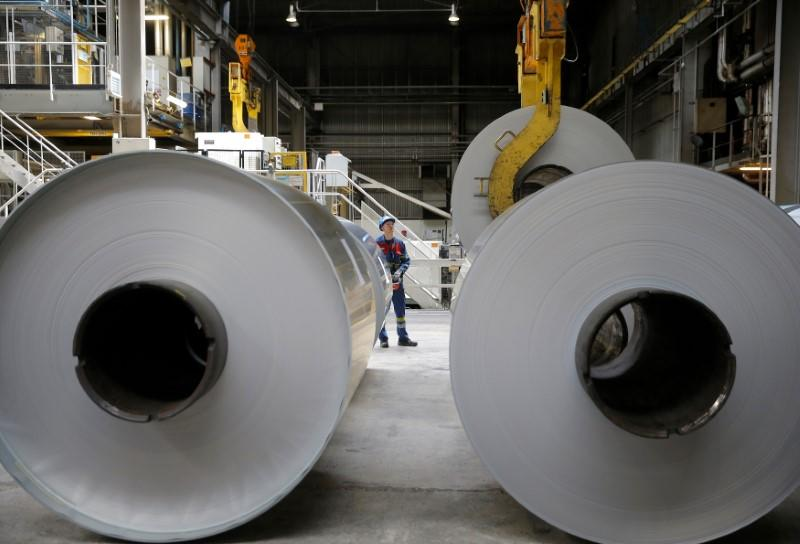 FILE PHOTO: An operator uses a hoist to lift a coil of aluminium at the Neuf-Brisach Constellium aluminium products company's production unit in Biesheim, Eastern France, April 9, 2018. REUTERS/Vincent Kessler