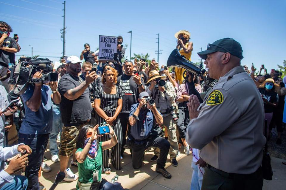 Protesters demonstrate in front of the Palmdale Sheriff's Station after Fuller's death.