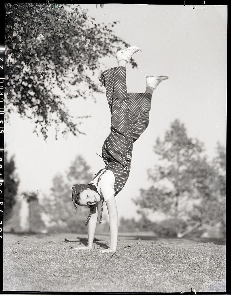 <p>Hollywood began releasing a series of promotional photos, like this one of Judy doing a handstand, to push their latest starlet. </p>