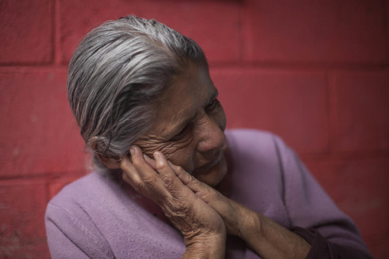 In this March 6, 2014 photo, Austina Machic, 76 years-old, pauses during an interview at her home in San Andres Itzapa, Guatemala. In November 1988 in the mountainous area of western Guatemala, 22 men who lived in the village of El Aguacate where massacred by leftists guerillas during the Guatemalan civil war. The case will be taken to court on Thursday, March 13, 2014, in which more than 30 persons are expected to testify. Machic's husband Horacio tajtaj Callejas was killed in the massacre. (AP Photo/Luis Soto)