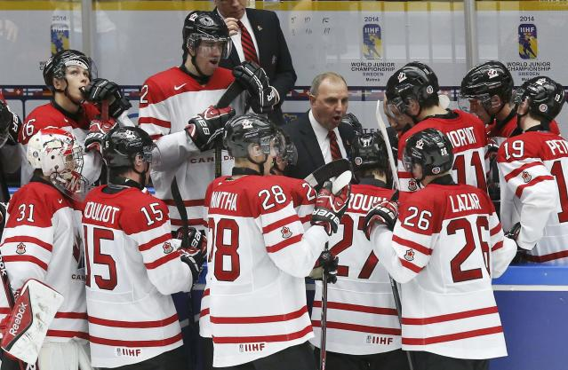 Canada's head coach Brent Sutter directs his team in the last minutes of play against Russia in the third period of their IIHF World Junior Championship bronze medal ice hockey game in Malmo, Sweden, January 5, 2014. REUTERS/Alexander Demianchuk (SWEDEN - Tags: SPORT ICE HOCKEY)
