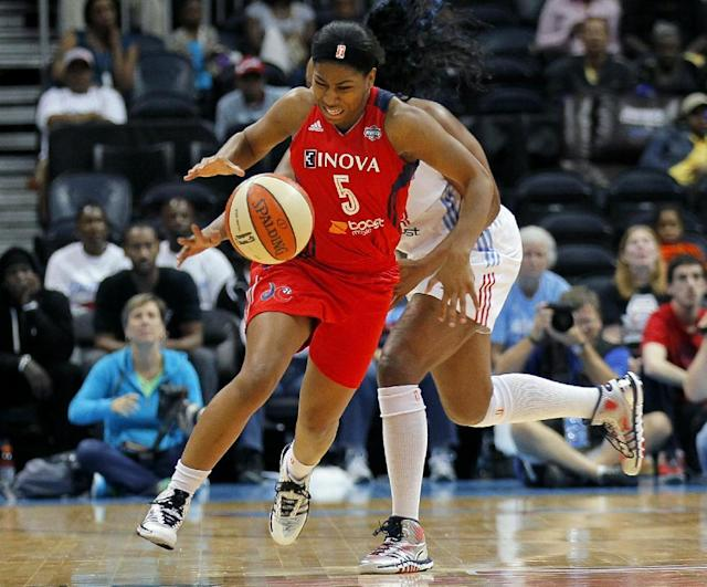 Washington Mystics guard Nadirah McKenith (5) is fouled by Atlanta Dream forward Le'coe Willingham (43) in Game 1 of aWNBA basketball Eastern Conference semifinals series, Thursday, Sept. 19, 2013, in Atlanta. (AP Photo/Todd Kirkland)