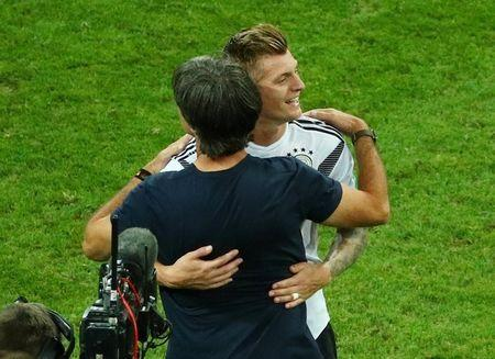 Soccer Football - World Cup - Group F - Germany vs Sweden - Fisht Stadium, Sochi, Russia - June 23, 2018 Germany's Toni Kroos and coach Joachim Low celebrate after the match REUTERS/Hannah McKay