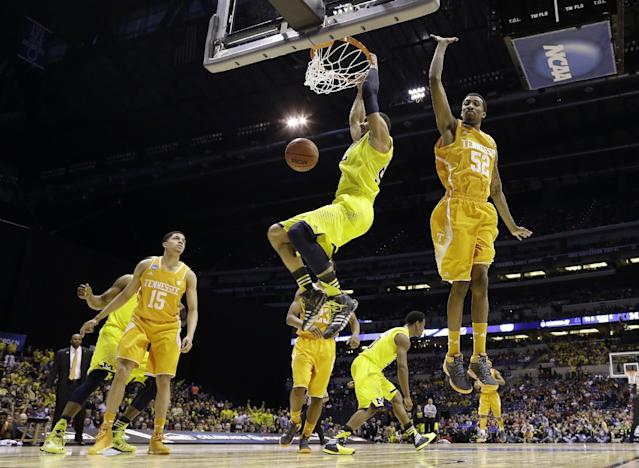 Michigan's Jordan Morgan dunks past Tennessee's Jordan McRae (52) during the first half of an NCAA Midwest Regional semifinal college basketball tournament game Friday, March 28, 2014, in Indianapolis. (AP Photo/David J. Phillip)