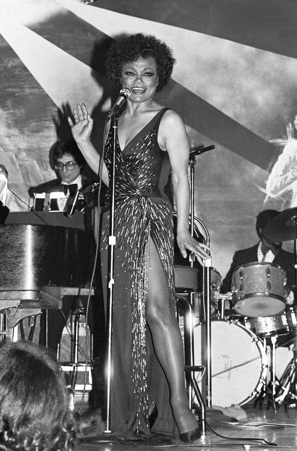 <p>Kitt, the consummate wearer of the shimmering evening gown, commands the stage in a dress boasting a deep V and high slit. </p>