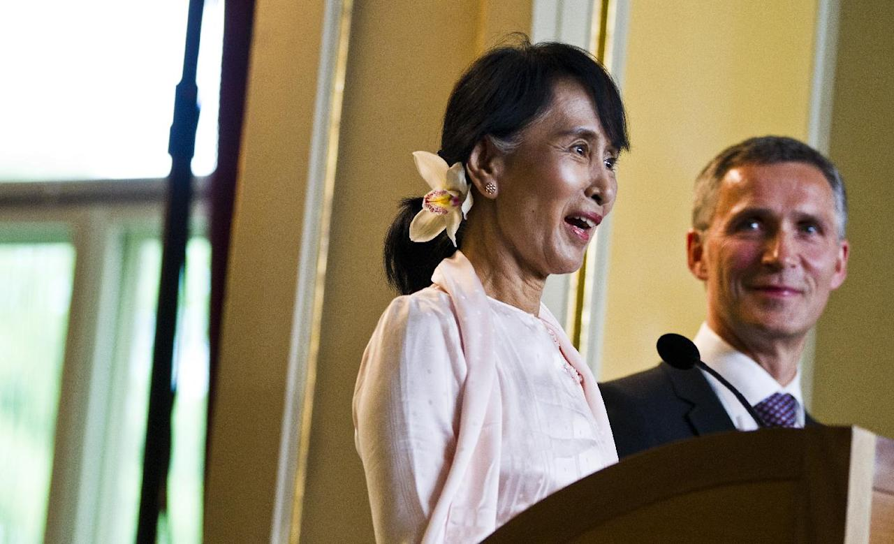 Myanmar opposition leader Aung San Suu Kyi at a press conference with Norwegian prime minister Jens Stoltenberg in Oslo, Friday, June 15, 2012. Suu Kyi formally accepts the Nobel Peace Prize on Saturday June 16, 2012, in the Norwegian capital. (AP Photo / Vegard Groett / NTB scanpix) NORWAY OUT