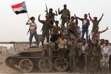 Members of UAE-backed southern Yemeni separatist forces stand atop a tank during clashes with government forces in Aden
