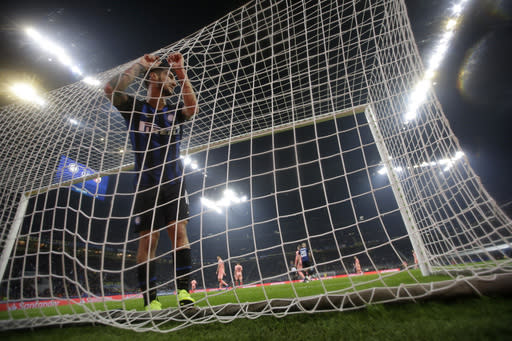 Inter midfielder Matteo Politano reacts after a missed scoring opportunity during the Champions League group B soccer match between Inter Milan and Barcelona at the San Siro stadium in Milan, Italy, Tuesday, Nov. 6, 2018. (AP Photo/Luca Bruno)