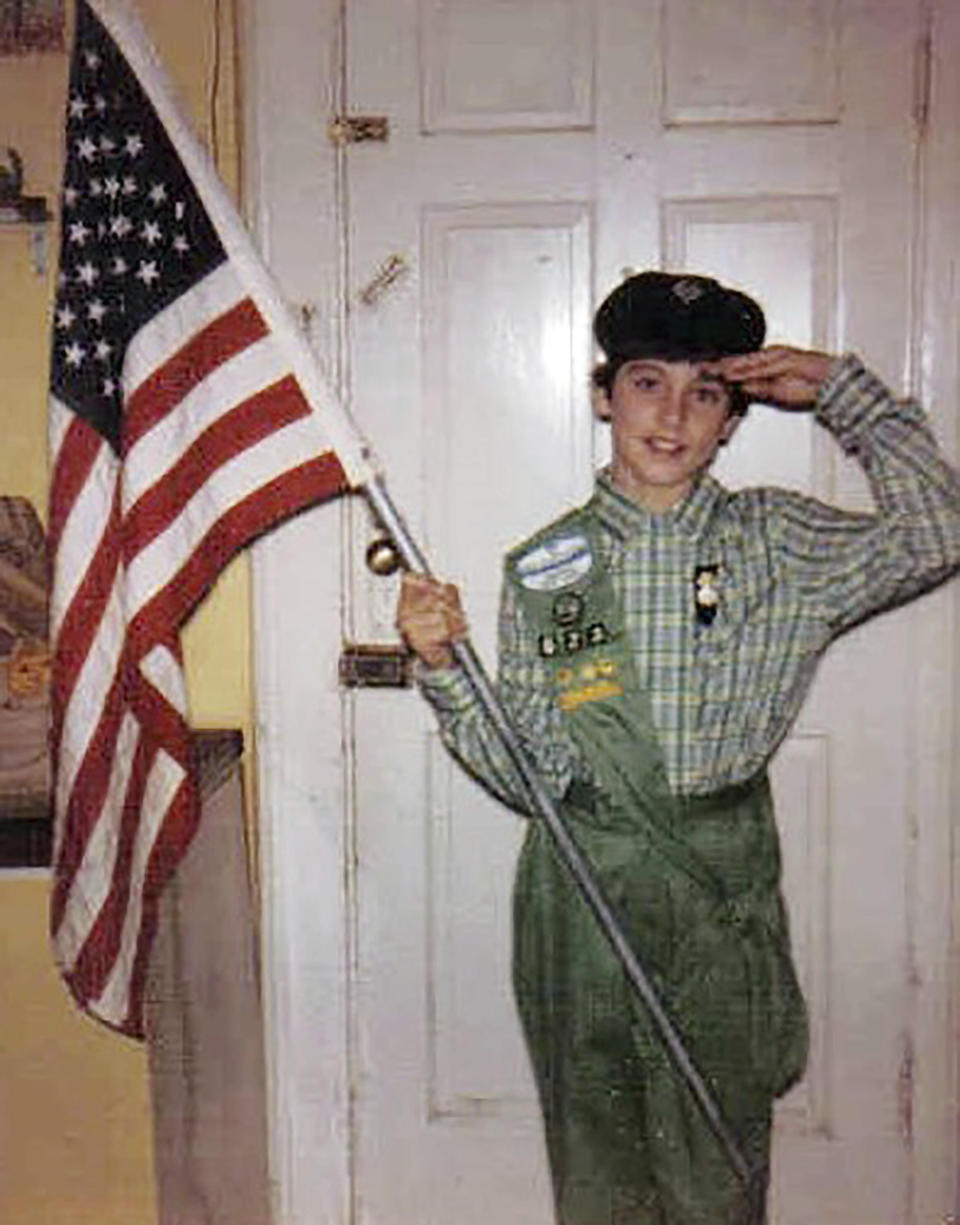 """This 1985 photo, provided in New York, Tuesday Aug. 4, 2020, shows Girl Scout Alice Weiss-Russell, age 14. As a Girl Scout growing up in upstate New York, Alice Weiss-Russell says she lived with a dark secret: The husband of her troop leader was sexually abusing her in the bathroom of a church basement where scout meetings were held in the 1980s. She has detailed her alleged ordeal in a new lawsuit filed against Girl Scouts of the USA, part of a flurry of child sex-abuse cases in New York using a """"look back window"""" for making civil claims against abusers.(Courtesy Alice Weiss-Russell via AP )"""