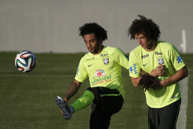 Brazil's Marcelo, left, and David Luiz train in Fortaleza, Brazil, Thursday, July 3, 2014. Brazil will face Colombia on Friday in a World Cup quarterfinal soccer match. (AP Photo/Felipe Dana)