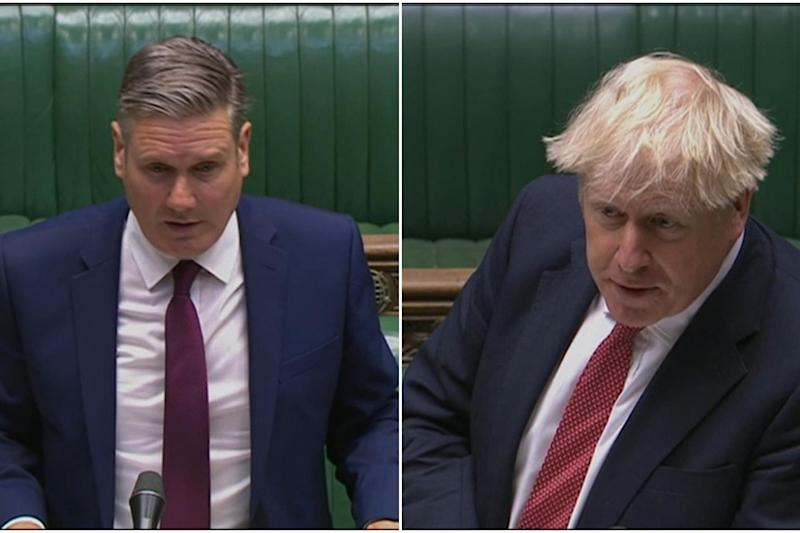 Boris Johnson and Keir Starmer in the Commons (PA)
