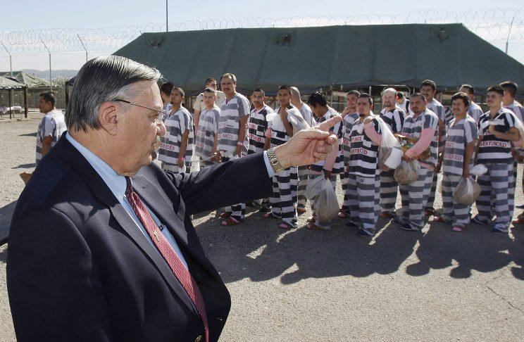In this Feb. 4, 2009, file photo, Maricopa County Sheriff Joe Arpaio, left, orders approximately 200 convicted illegal immigrants handcuffed together and moved into a separate area of Tent City, for incarceration until their sentences were served and they were deported to their home countries. (Photo: Ross D. Franklin, File/AP)