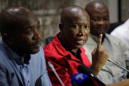 FILE PHOTO: Julius Malema, leader of the opposition Economic Freedom Fighters (EFF) party, speaks during a media briefing at Parliament in Cape Town, South Africa, February 12, 2018. REUTERS/Sumaya Hisham/File Photo