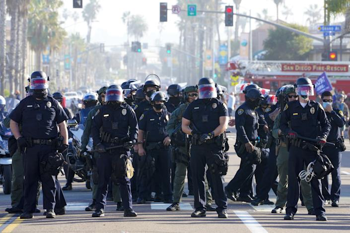 San Diego police set up a security line to keep pro- and anti-Trump groups apart.