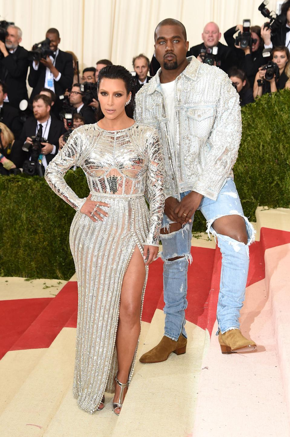<p>Kim and Kanye never fail to steal the spotlight and at the 2016 Met Gala, the rapper's outfit got fashion industry insiders talking. Ignoring the dress code, Kanye donned a pair of seriously ripped Fear of God jeans and they came with a costly price tag of £633.<br>He teamed the look with a bespoke jacket by Balmain which in fact took longer to make than his wife Kim's dress. <em>[Photo: Getty]</em> </p>