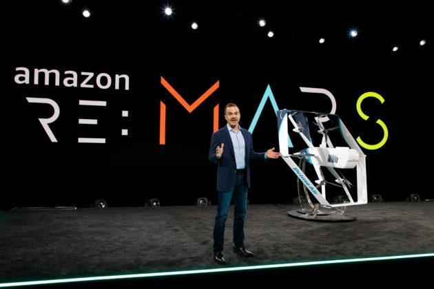 Jeff Wilke, CEO of Amazon's Worldwide Consumer Business, shows off the company's delivery drone at an Amazon conference in Las Vegas in June 2019. (Amazon Photo / Jordan Stead)