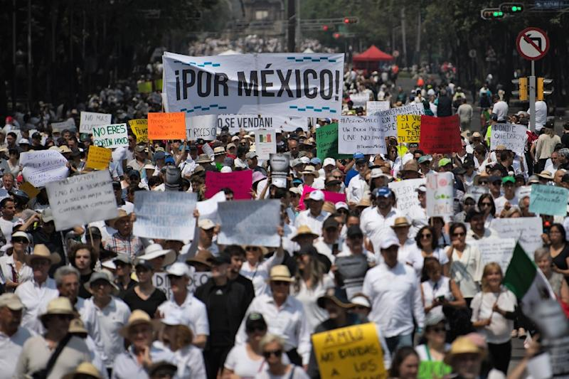 "People take part in the so-called ""March of Silence"" against Mexican President Andres Manuel Lopez Obrador's policies in Mexico City, on May 5, 2019; the economy contracted in the first quarter"
