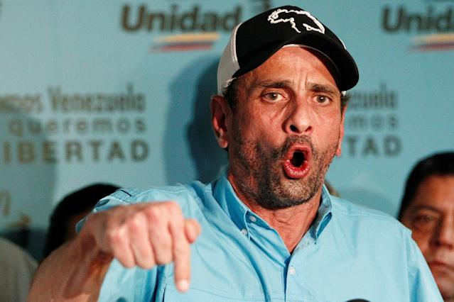 <p>Venezuelan opposition leader and Governor of Miranda state Henrique Capriles talks to the media during a news conference in Caracas, Venezuela July 30, 2017. (Christian Veron/Reuters) </p>